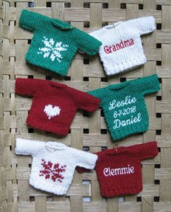 sweater ornaments in a basket